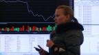Informationsbildschirm im Büro der Moskauer Börse in Moskau am 24. März 2014