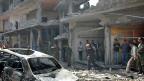 Eine Strasse in Homs - nach der Explosion einer Autobombe am 29. April 2014.