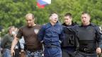Pro-russische Milizien in Donezk. Sie lehnen  die Aufforderung von Präsident Wladimir Putin ab, nach einer diplomatischen Lösung zu suchen.