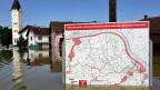 Im Überschwemmungsgebiet in Bosnien wird eine alte Bedrohung zur neuen Gefahr: Karte mit Informationen zur Minengefahr in der Umgebung eines bosnischen Dorfes.