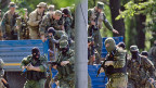 Bei Kämpfen in Donezk wurden nach der Darstellung der prorussischen Rebellen mehr als 50 ihrer Kämpfer getötet.