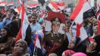 Ägypter singen Parolen auf dem Tahrir-Platz. Der ehemalige ägyptische Armeechef Abdel Fattah al-Sisi gewann die Präsidentschaftswahl in Kairo am 3. Juni 2014.
