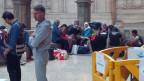 Syrische Flüchtlinge in der Bahnhofshalle von Milano Centrale am 20.6.2014.