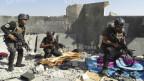 Obama will keine toten US-Soldaten. Bild: Mitglieder der irakischen Spezialeinsatzkräfte während Zusammenstössen mit Isis-Terroristen in der Stadt Ramadi am 19. Juni 2014.
