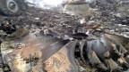 Wrackteile der abgestürzten Boeing 777 in der Region Donezk, Ukraine. Das Unglück forderte 298 Todesopfer.
