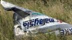 Ein Wrackteil der abgestürzten Maschine der Malaysian Airlines.