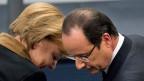 Die deutsche Bundeskanzlerin Merkel und der französische Präsident Hollande.