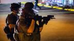 Ferguson kommt nicht zur Ruhe. Polizeieinsatz nach Plünderungen in einem Supermarkt in Ferguson, Missouri.