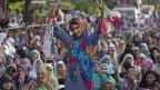 Anhänger des pakistanischen Klerikers Tahir-ul-Qadri während Anti-Regierungsprotesten in Islamabad, Pakistan, am 18. August 2014.