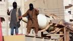 Militante islamistische Kämpfer der Terrormiliz Islamischer Staat Isis.