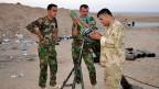 Erhalkten die schlecht ausgerüsteten kurdischen Peshmerga-Truppen in Nordirak deutsche Waffen, um die IS-Milizen zu bekämpfen?