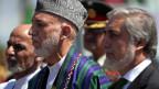 Drei Männer und die Macht in Afghanistan: Noch-Präsident Karzai (Mitte) sowie die Kandidaten Abdullah (re) und Ghani (li).