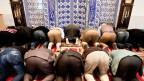Betende Muslime in einer Moschee in St. Gallen.
