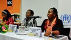 Drei Vertreterinnen des Projekts «Mariposa» bei der Medienkonferenz in Genf.