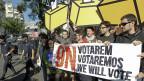 «Wir werden abstimmen», steht auf dem Plakat junger Katalanen, am 30. September in Madrid.