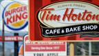 Der Fastfood-Riese Burger King hat seine Firmenzentrale nach Kanada verlegt,  indem er die Donut-Kette Tim Hortons übernommen hat.