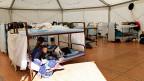 Flüchtlinge in einem provisorischen Flüchtlingscamp in München.