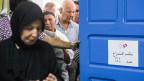 Urnengänger stehen Schlange in Tunis