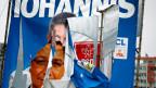 Zerschlissenes Wahlplakat in Rumänien.