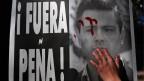 Die Bevölkerung hat ihr Vertrauen in den Staat, in die Polizei längst verloren. Plakat mit Enrique Peña Nieto.