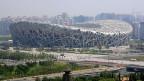 Viele der Olympia-Stadien sind seit dem Herbst 2008 meistens leer. Bild: Das sogenannte Bird's Nest der Schweizer Architekten Herzog& deMeuron in Peking.
