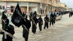 Bewaffnete IS-Kämfer.