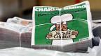 Viele der Glücklichen, die ein Exemplar von «Charlie Hebdo» in den Händen halten, sehen den Kauf der Zeitung als Geste der Solidarität.
