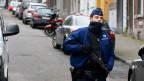 Die belgische Polizei blockiert die Strasse vor einer Wohnung im Zentrum von Verviers im Osten von Belgien am 16. Januar 2015.
