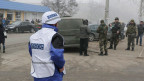 Die OSZE-Beobachter untersuchen die Bombardierung auf ein ziviles Quartier in Mariupol.