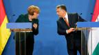Die deutsche Bundeskanzlerin Merkel und der ungarische Premier Orban in Budapest.