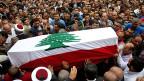 Der Beerdigungszug für ein Opfer islamistischer Radikalisten im Norden Libanons.