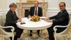 Merkel, Putin und Hollande haben sich am Freitag zu Gesprächen in Moskau getroffen. Archiv.