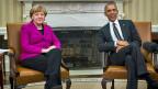 Die deutsche Bundeskanzlerin Merkel und US-Präsident Obama posieren für ein Foto - bevor sie über ihre Positionen zum Krieg in der Ukraine diskutieren.
