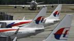 Von den 20 000 Angestellten der Malaysia-Airlines sollen 6000 das Unternehmen verlassen .