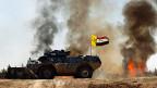 Die irakischen Streitkräfte während eines Gefechts mit den IS-Milizen, in der Nähe von Tikrit.