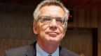 Mittel- und osteuropäische Staaten könnten sich vorstellen, sich zu beteiligen, aber auf freiwilliger Basis, sagt Deutschlands Innenminister Thomas de Maizière.
