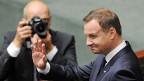 In einer Erklärung vor den Abgeordneten forderte der neue polnische Präsident Andrzej Duda eine stärkere Nato-Präsenz in seinem Land und in ganz Osteuropa.