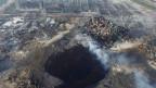 Blick auf das zerstörte Gelände  in der Hafenstadt Tianjin – am Samstag kam es zu weiteren Explosionen.