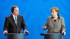 Der schwedische Premier und die deutsche Bundeskanzlerin - kann Deutschland von Schwedens Erfahrungen mit der Integration von Flüchtlingen profitieren?