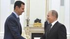 Händeschütteln im Kreml: Russlands Präsident Wladimir Putin (rechts) begrüsst den syrischen Präsidenten Bashar al-Assad am 20. Oktober 2015.