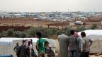 Jede Verschärfung des Konflikts verstärkt das Leiden der syrischen Bevölkerung enorm. Bild: Flüchtlingslager Atma an der syrisch-türkischen Grenze.