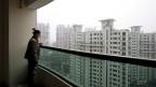 Ganz ohne Sorgen ist der neue chinesische Mittelstand nicht: «Manche vergleichen Chinas Wirtschaft mit einem Fahrrad, das viel zu schnell fährt und nun abgebremst werden muss. Ob das ohne Sturz möglich ist, weiss niemand», sagt Herr Hu Xixiang. Bild: Blick über ein Neubauquartier.