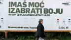 Wahlkampagne, um kroatische Stimmbürgerinnen und Stimmbürger an die Urne zu locken:  «Du hast die Macht deine Farbe zu wählen». Die Banken bezüglich der Schweizer-Franken-Kredite in die Verantwortung zu ziehen, ist Teil der Wahl-Strategie der Regierungspartei.