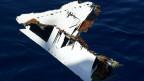 Wrackteil  des abgestürzten Flugzeugs