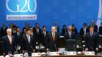 Die Staats- und Regierungschef am G20 halten eine Gedenkminute ab.
