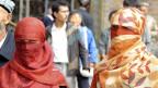 Wegen Spannungen zwischen muslimischen Uiguren und Han-Chinesen gilt Xinjiang seit Jahren als Konfliktherd. Uigurische Frauen in Xinjiang.