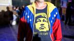 «Por ahora y por siempre», «für jetzt und für immer» steht unter dem Portrait von Hugo Chavez auf dem T-Shirt eines venezolanischen Regierungsanhängers. Die Wahlen vom Sonntag stellen dieses «für immer» nun in Frage.