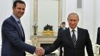 Der Teilrückzug russicher Truppen aus Syrien – ein geschickter Schachzug? Bild: Der syrische Präsident Assad und der russische Präsident Putin.