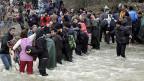 Hunderte Flüchtlinge, die durch einen reissenden Fluss nach Mazedonien gelangt waren, sind inzwischen wieder im griechischen Zeltcamp.