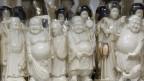 In China sind geschnitzte Elfenbeinskulpturen sehr beliebt.